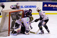 Ubin and Christian Borgatello  of HC Valpusteria  and Nicola Fontanive of HC Milano during a game Stock Image