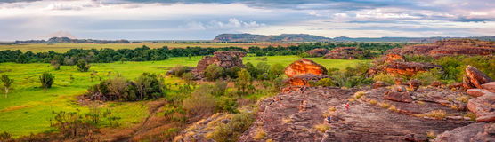 Ubirr Rock panorama at sunset -Northern Territory, Australia. Ubirr Rock, Australia -May 29, 2016: People gather to watch the sunset, but it is worth looking the Stock Photography