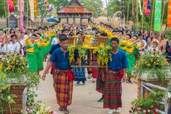 Parade of Buddha images together with Thai traditional dancing. Ubon Ratchathani, Thailand - May 2, 2016: People celebrating Songkran annual festival with parade Royalty Free Stock Image