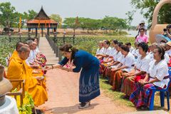 People pouring water to seniors` hands to ask for blessing. Ubon Ratchathani, Thailand - May 2, 2016: People pouring water to seniors` hands to ask for blessing Stock Photo