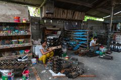 UBUD/BALI-APRIL 27 2019: Two female craftsmen from Ubud were making mask crafts that were drawn and colored using dark and stock image