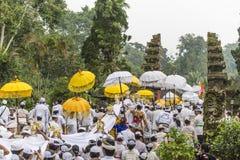People celebrating a holly day near Ubud, Bali. Ubud, Bali, Indonesia – February 19: White dressed Hindu worshippers celebrating a holly day at a small village Stock Images