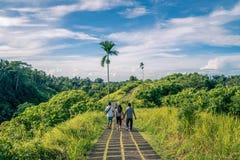 Tourist taking a guided tour of the ridge walk in Ubud. Ubud, Bali, Indonesia - January 2019: Tourist taking a guided tour of the ridge walk in Ubud royalty free stock photo