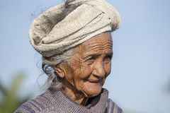 Portrait old poor woman to Bali island. Inhabitants of Bali are kind and friendly even in old age. UBUD, BALI, INDONESIA - MARCH 19, 2015 : Portrait old poor royalty free stock images