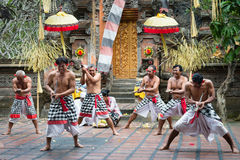 Traditional ritual Kris dance show on Bali. UBUD, BALI, INDONESIA - SEP 21: Kris wielding men perform ritual dance on traditional balinese Barong show on Sep 21 Stock Photos