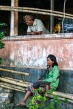 An old couple relaxed at there old house. Travel around Indonesia. royalty free stock photos