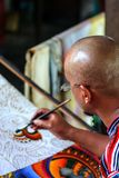 Painter at the workplace. Art of Indonesia. royalty free stock photo