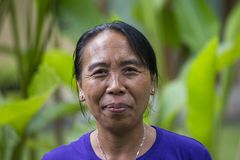Portrait balinese woman in local market in Ubud, Bali, Indonesia. UBUD, INDONESIA - APRIL 17, 2017 : Portrait balinese woman in local market in Bali royalty free stock image