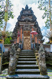 UBUD, INDONESIA - AUGUST 29, 2008: Ancient hindu temple with wal Stock Images