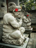 Ubud Stone Carving Pair. A pair of stone carvings of demons and deities at a house entrance in Ubud, Bali stock image