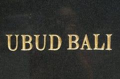 UBUD - testo di BALI sulla lastra di marmo nera fotografia stock