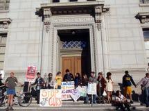 UC Berkeley Protesters link arms around a building stock photos