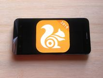 UC Browser app. On smartphone kept on wooden table stock images