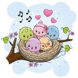 Uccelli del fumetto in un nido su un ramo