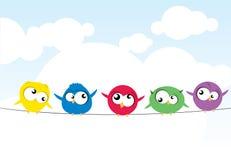 Uccelli su collegare Immagini Stock