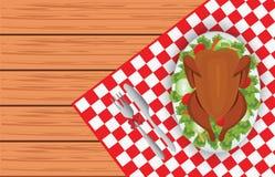 Uccello arrostito del tacchino sul piatto ovale con la forcella e sul coltello sulla linguetta rossa Immagini Stock Libere da Diritti