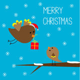 Uccello di volo ed uccello di bambino. Carta di Buon Natale. Fotografia Stock