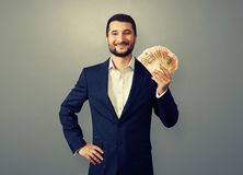 Uccessful businessman holding paper money Royalty Free Stock Photos