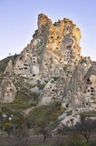 Uchisar Castle. The Uchisar Castle in Cappadocia against the blue sky at autmn evening Royalty Free Stock Image