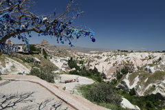 Uchisar Castle and Evil Eye Beads Tree in Cappadocia Royalty Free Stock Image