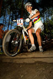 UCI MTB Woman running over drop off Royalty Free Stock Photography