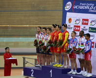 UCI World Cup Classics cycling event. BEIJING - JANUARY 22: Teams awarded are on the podium during Men's Team Sprint medal ceremony in the UCI World Cup Classics stock photo
