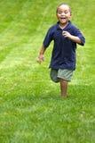 uciekaj chłopcze Fotografia Royalty Free