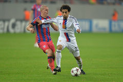 UCL: Mohamed Salah and Alexandru Bourceanu Stock Images