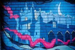 Ucrânia, Lviv o 9 de janeiro de 2015: grafittis, arte da rua nas paredes das construções na cidade Fotos de Stock