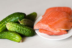 Cucumber  and a red fish Royalty Free Stock Image