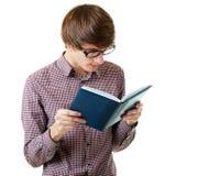 Uczeń czyta książkę Obrazy Royalty Free