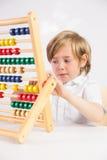 Uczeń robi maths na abakusie Fotografia Stock