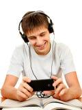 Uczeń słucha muzyka fotografia stock