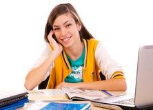 Uczeń używa jej telefon komórkowy Obraz Royalty Free