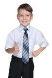 Uczeń z jego kciukiem up zdjęcie stock