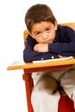Uczeń: Zanudzający uczeń Przy biurkiem Obrazy Royalty Free