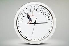 Uczeń z książkami i spacerami na zegarze Obrazy Stock