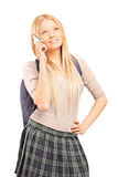 Uczennica opowiada na telefonie komórkowym Obraz Royalty Free