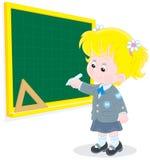 Uczennica pisze na blackboard Obrazy Stock