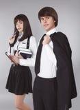 ucznie Ufni nastolatkowie w mundurka szkolnego portrecie Handso Zdjęcia Stock