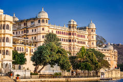 Udaipur castle India. Udaipur castle shot from the boat at sunset, India Stock Image