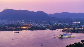 Udaipur city at lake Pichola in the evening, Rajasthan, India. Royalty Free Stock Photos