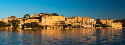 Udaipur cityscape at sunset. The majestic city palace on Lake Pichola, travel destination in Rajasthan, India Stock Photo