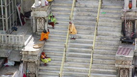 UDAIPUR, INDIA - APRIL, 2013: People sitting on stairs stock footage