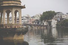 UDAIPUR, INDIA - SEPTEMBER 15, 2017: Lake Pichola with City Pala. Ce view in Udaipur, Rajasthan, India royalty free stock images