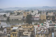 UDAIPUR, INDIA - SEPTEMBER 15, 2017: Lake Pichola with City Pala. Ce view in Udaipur, Rajasthan, India royalty free stock photo