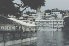 UDAIPUR, INDIA - SEPTEMBER 15, 2017: Lake Pichola with City Pala. Ce view in Udaipur, Rajasthan, India stock photos