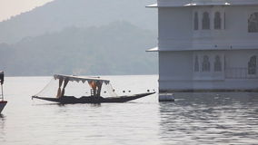Udaipur lake. UDAIPUR, INDIA - NOVEMBER 24, 2012: Boat passing along the bank in Udaipur stock video footage