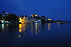 Udaipur, Rajasthan, India. Night view of the old city waterfront Stock Photos