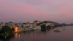 Udaipur Rajasthan India. Time lapse at sunset from above. Travel destination and tourism landmarks stock video footage